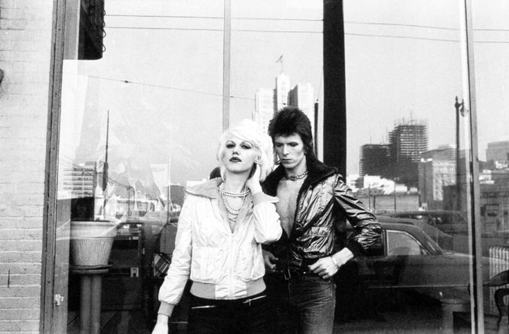 David Bowie & Cyrinda Foxe on the set of 'The Jean Genie' promo filmed by Mick Rock