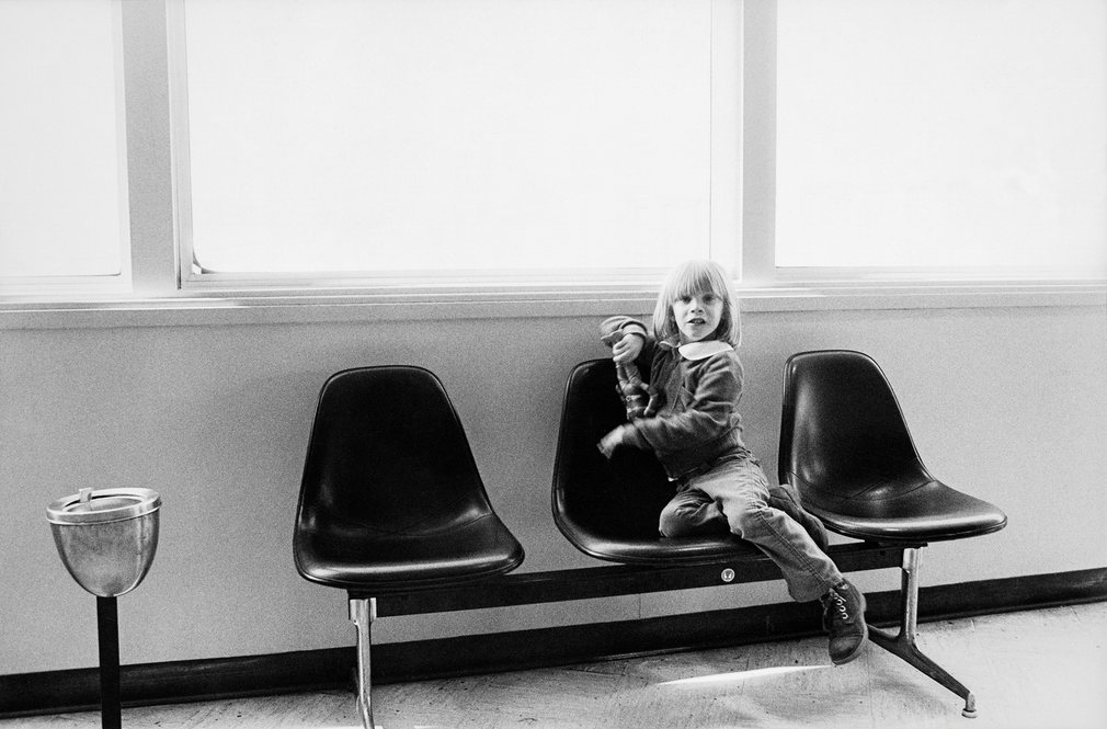 Bowie's five-year-old son Zowie Duncan Jones passes time in an airport lounge by playing with his action figure toy between stops on the tour in 1976