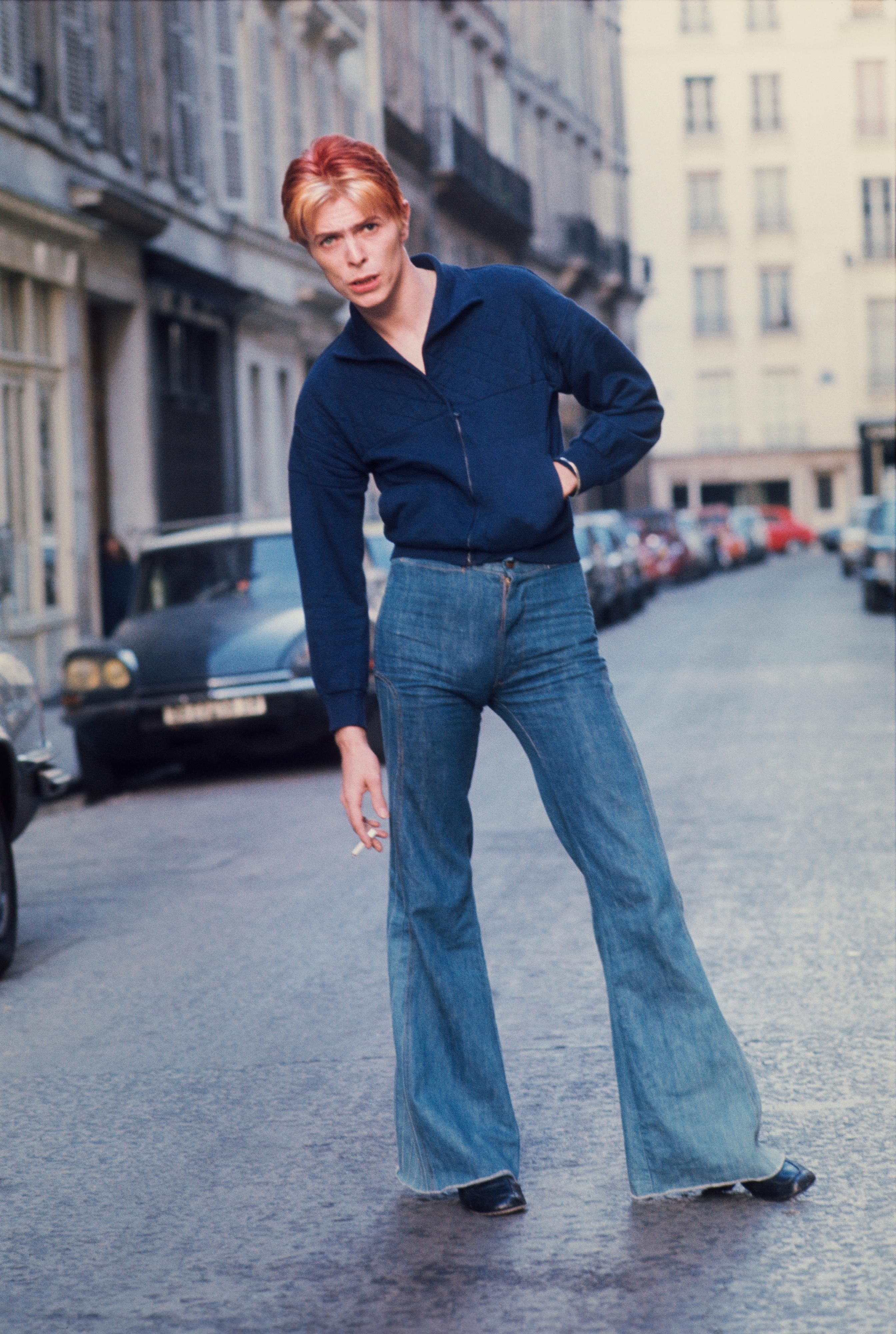 David Bowie in the street outside L'Hotel in Paris in 1976