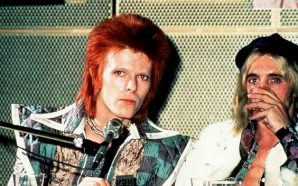 David Bowie and Mick Ronson during a press conference at RCA Studios in New York, 1972. By Bob Gruen