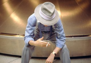David Bowie photographed on baggage carousel by Denis O'Regan in 1983 © Denis O'Regan