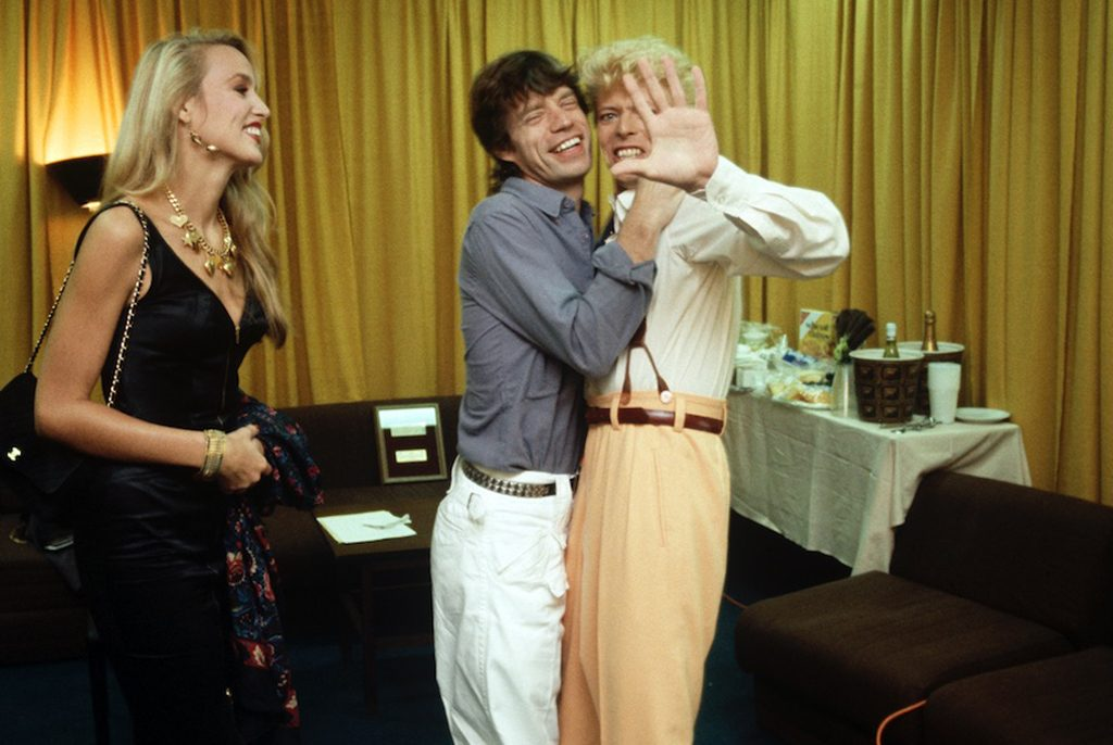 David Bowie, Jerry Hall and Mick Jagger photographed by Denis O'Regan in 1983 © Denis O'Regan
